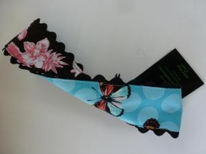 pink and white islands on black/dotty butterflies on blue w/ black rickrack