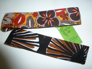black, white, yellow and red cotton hibiscus print/Marrimekko dark slices