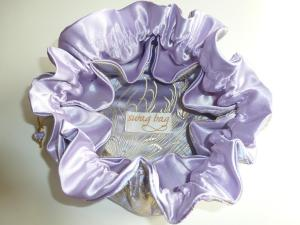 gleaming lilac satin pockets in lilac and gold brocade