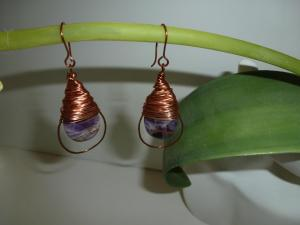 Dogtooth amethyst ovals lushly wrapped in copper inside copper hoops