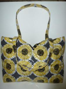 rows of sunflowers burst from dark gray BPA-free vinylized cotton tote